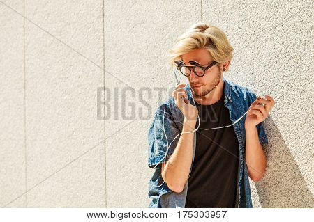 Hipster Man Smiling Listening Music Through Earphones