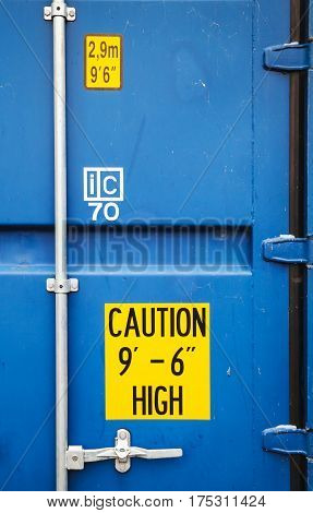 Yellow Warning Signs On Blue Container