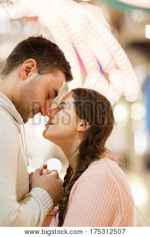Romantic pictures of young couple enamored at mall