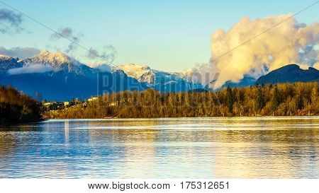 The quiet waters of the Fraser River viewed from Brea Island at Fort Langley in British Columbia on a clear winter day