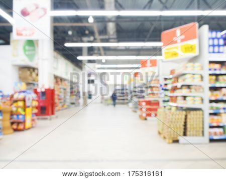 Abstract blurred supermarket aisle with colorful shelves as background. Blurres hypermarket