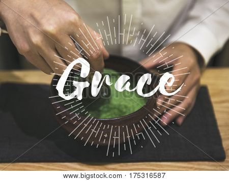 Hands with Japanese Green Tea and Grace Graphic Word
