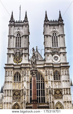 Front Facade Westminster Abbey Church London England. Westminister Abbey has been the burial place of Britain's monarchs since the 11th century and is the setting for many coronations and weddings.