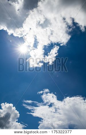 Attractive photo of beautiful blue sky with cloudy and sunbeam. Sunlight with lens flare. Outdoor at the daytime on summer day. Beautiful nature sky composition.