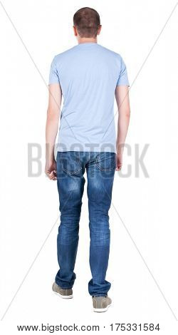Back view of young man in t-shirt and jeans  looking. guy standing putting one foot in front. Rear view people collection.  backside view of person.  Isolated over white background.