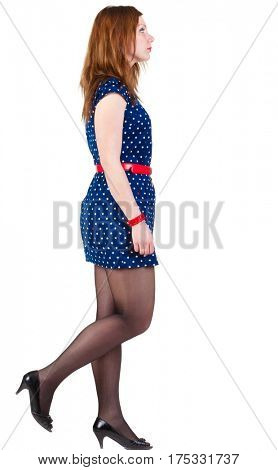 back view of going  woman  in blue dress. beautiful brunette girl in motion.  Rear view people collection. backside view of person.   Isolated over white background.