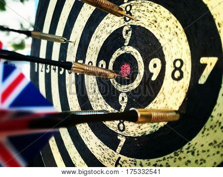 Close up picture of darts on the dartboard.