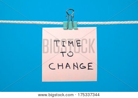 Pink Paper Note Hanging On The String With Text Time To Change