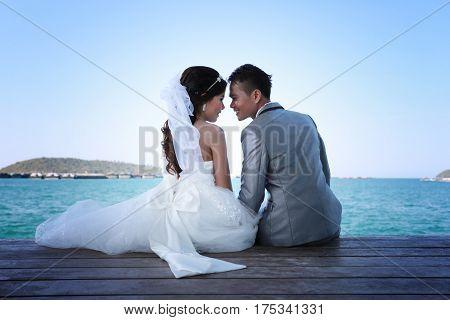 Pre Wedding photography thai couples on a wooden Atsadang bridge of Koh Si Chang Island at Thailand in concept love of memory.