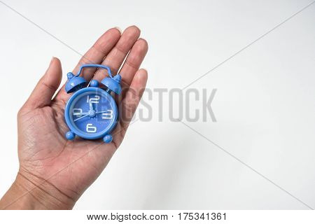 isolated business concept of deadline woman hold clock in left hand