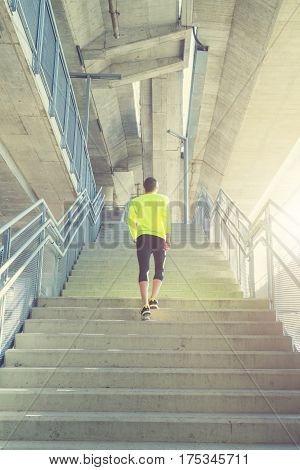 Urban jogger going up the stairs / staircase.