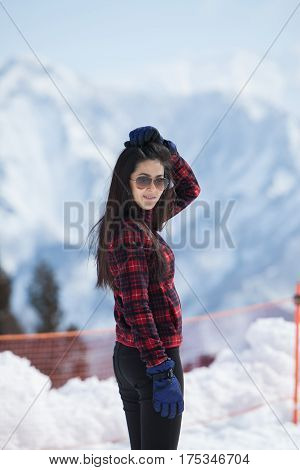 Image of  woman with background snow mountain