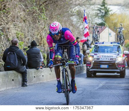 Conflans-Sainte-HonorineFrance-March 62016: The Ethiopian cyclist Tsgabu Gebremaryam Grmay of Lampre-Merida Team riding during the prologue stage of Paris-Nice 2016.