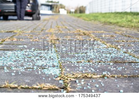 Broken glass on the asphalt after break-in