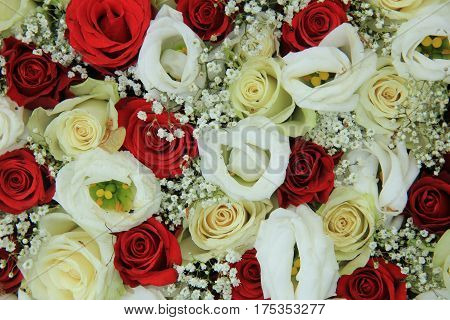 Red and white roses in a floral wedding centerpiece