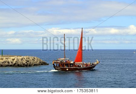 Torviscas harbour Tenerife Canary Islands Spain Europe - June 15 2016: Tourists going on a sea tour on a sailboat