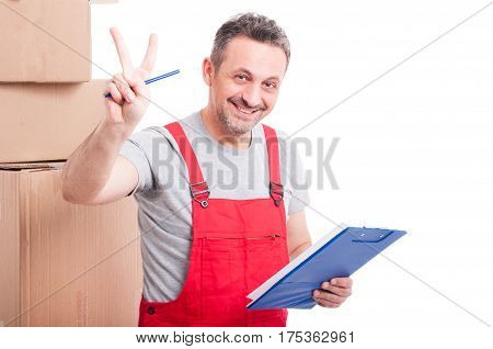 Mover Guy Smiling And Showing Victory Holding Clipboard