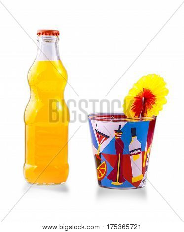 Glass bottle with juice and a glass of cocktail on white background