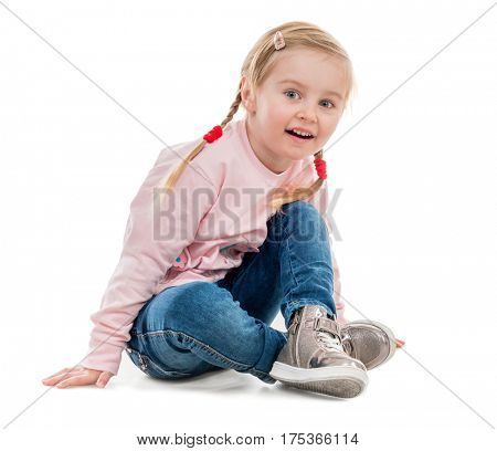 lovely little girl sitting on the floor, isolated on white background