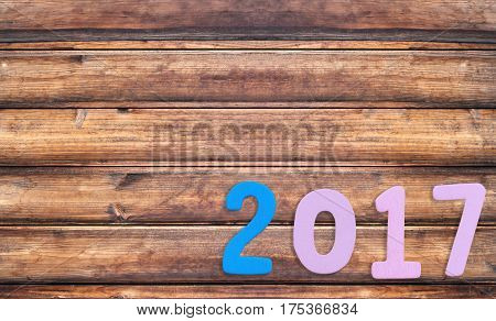 Number two thousand seven of wooden text on brown old wood floor in concept of the New Year 2017.