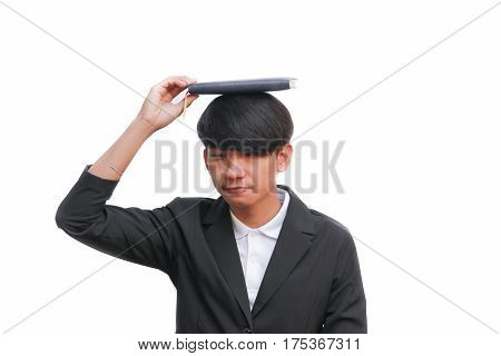 student with book on the head against a white background