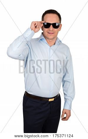 Young Man With Cheerful Smile In Formal Shirt And Trousers Wears Black Trendy Sunglasses, Isolated O