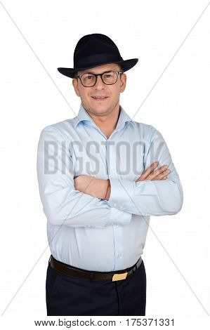 Young Businessman In Blue Fedora Hat And Glasses Wearing Blue Shirt And Trousers. Holding His Arms C