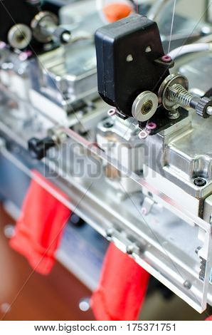 Machinery and equipment in a spinning production company interior design. Hoisery factory. Textile fabric. Shaping socks