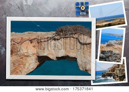 Beautiful snapshots of various Cyprus landscapes in wooden frames arranged on rustic background with copy space horizontal top view.