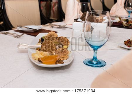 Appetizing food on a banquet table. Snacks, cheese, grapes