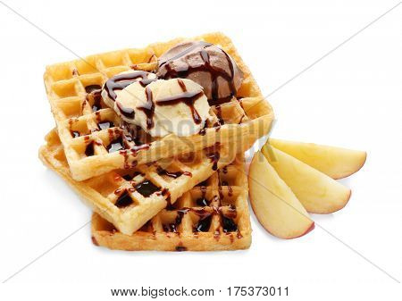 Tasty waffles with delicious fruit, ice-cream and syrup on white background