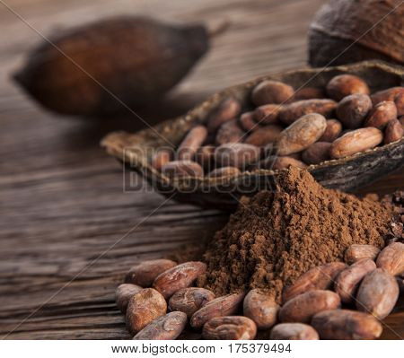 Cocoa pod on wooden background