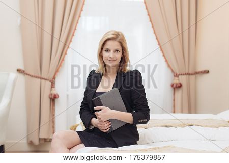 Young entrepreneur woman in elegant hotel room