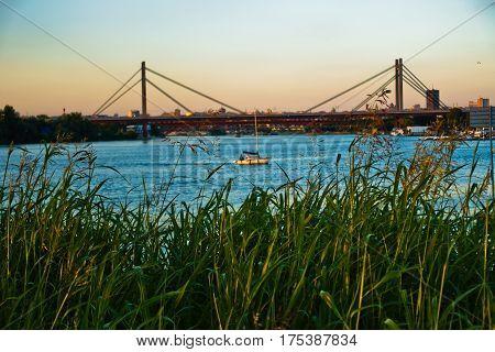 Railroad cable bridge over Sava river at golden hour in Belgrade, Serbia