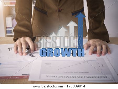 Business worker with graph growth on desk office. concept analysis finance.