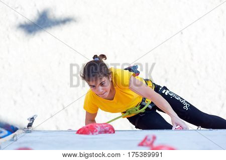 Junior female climber makes a try on the track of lead climbing competition. National Climbing Championship, Dnipro, Ukraine, May 20, 2016, Female semifinal, Lead climbing