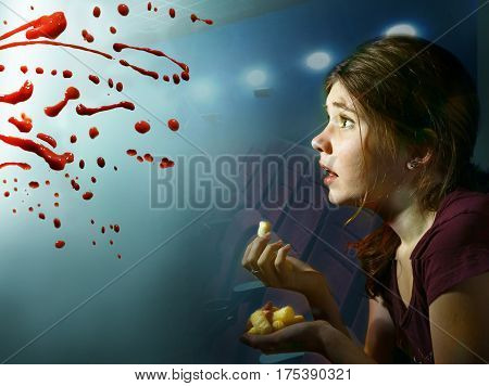 Teen Girl Watching Horror Movie With Pop Corn