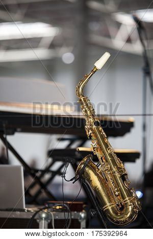 Golden saxophone on the stage before a concert