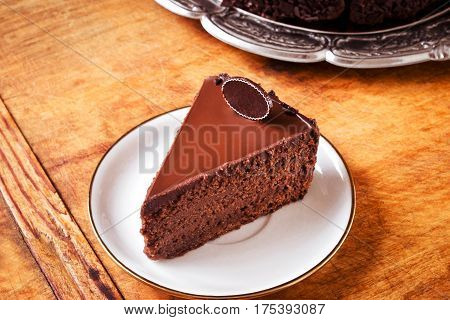 Triple chocolate cake on plate, ready to eat