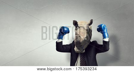 Rhino dressed in business suit . Mixed media