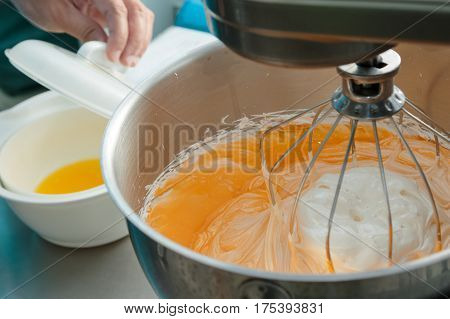Chef preparing whipping cream to make a cake