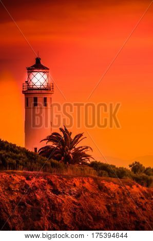 The Point Fermin lighthouse lit up at sunset