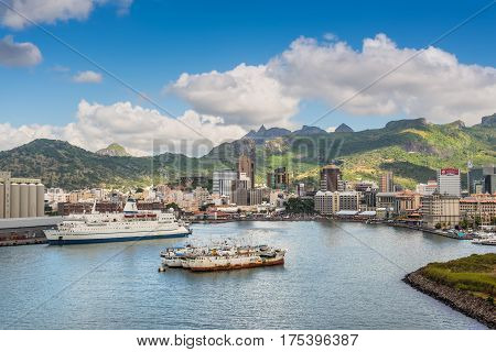 Port Louis Mauritius - December 12 2015: Port Louis cityscape Mauritius. Ships in the harbor in the foreground. The city is the country's economic cultural political centre and most populous city.