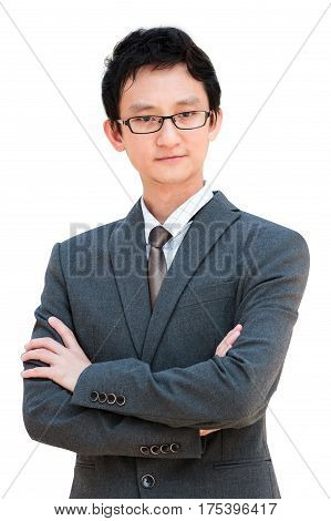 Young Asian Man In Business Attire With Crossed Arms