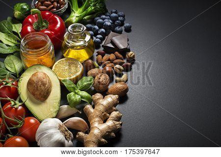 Mixed fresh healthy food on dark background