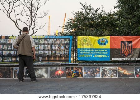 ODESSA UKRAINE - AUGUST 14 2015: Man paying respect to the people killed during the Maidan - Euromaidan revolts of 2014 at a memorial erected in Odessa