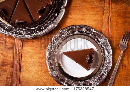 Chocolate cake dessert on wooden table, directly above