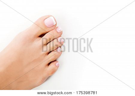 Perfect hands on female feet isolated on white background