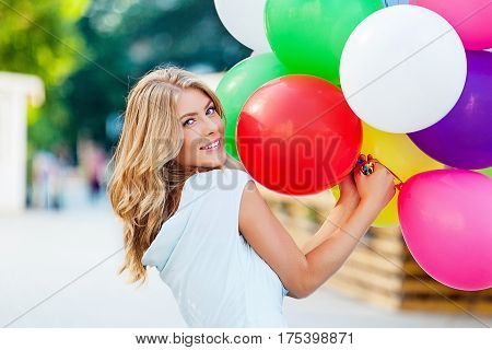 Attractive Young Woman with Birthday Balloons and Red Gift Box