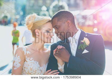 Loving Couple Of Cute Bride And African American Groom